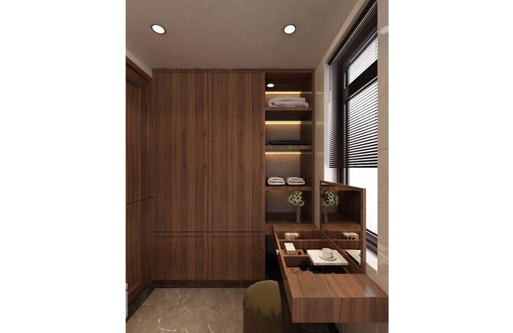 Bàn trang điểm và tủ quần áo được làm bằng gỗ, tạo nên điểm nhấn cho căn phòng